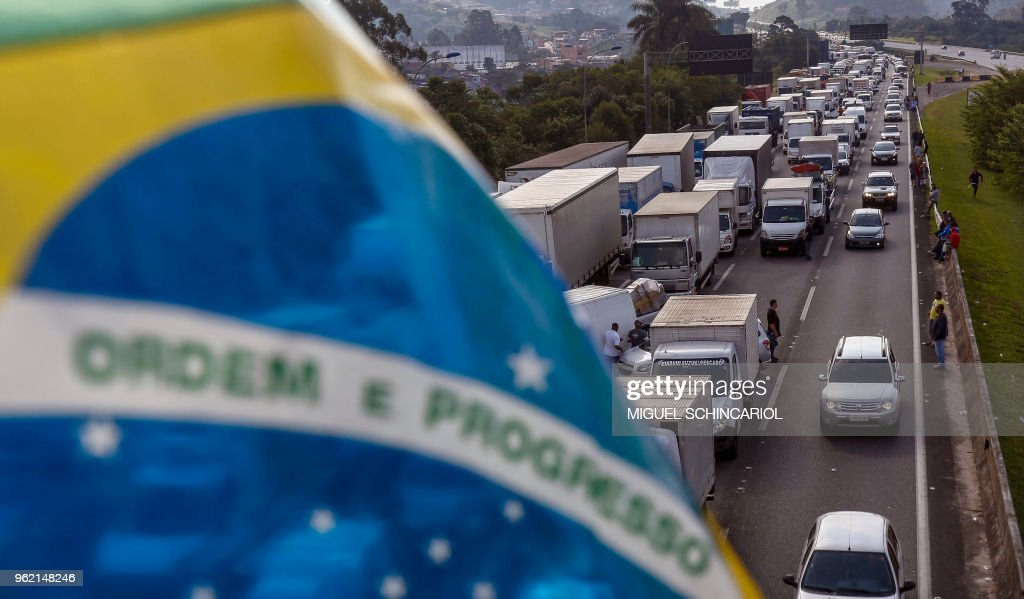 Brazilian truck drivers block the Imigrantes road, 23 kilometres from Sao Paulo, during the fourth day of strike to protest rising fuel costs in Brazil, on May 24, 2018.