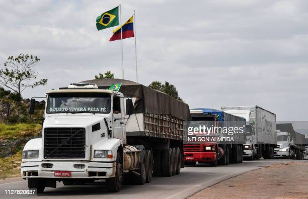 Brazilian trucks which were withheld in Venezuelan territory cross from Venezuela to Pacaraima Roraima state Brazil on February 27 2019 Venezuela's...