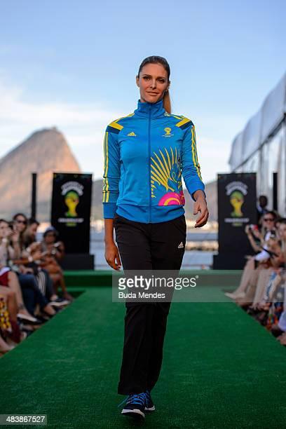 Brazilian TV presenter and model Fernanda Lima walks the runway of Volunteers Uniform Launch 2014 FIFA World Cup Brazil during Fashion Rio Summer...