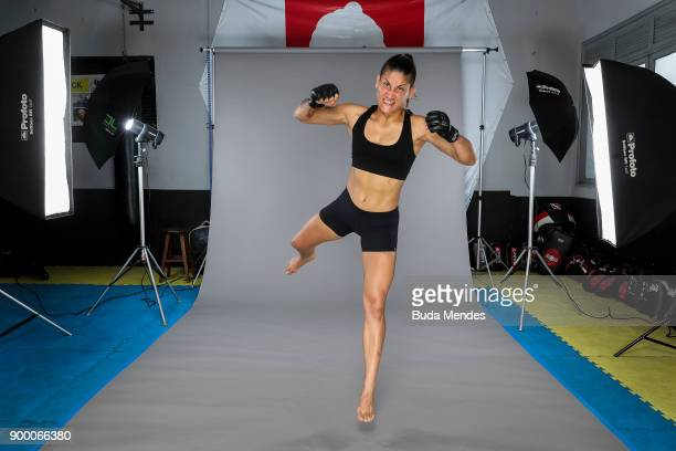 Brazilian UFC flyweight fighter Priscila 'Pedrita' Cachoeira poses for photographer during a UFC Photo Session at School of Lutas Niteroi on December...