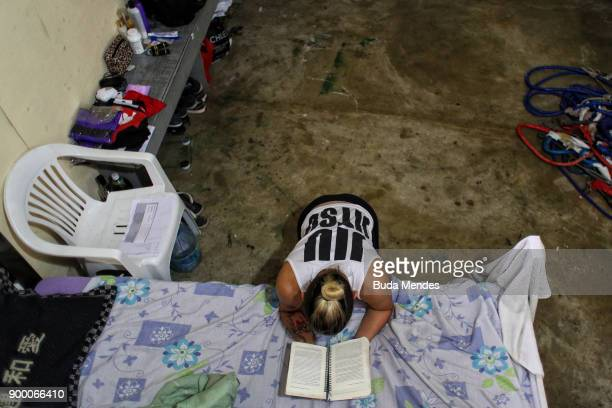 Brazilian UFC flyweight fighter Priscila 'Pedrita' Cachoeira prays before another day of training at School of Lutas Niteroi on December 29 2017 in...