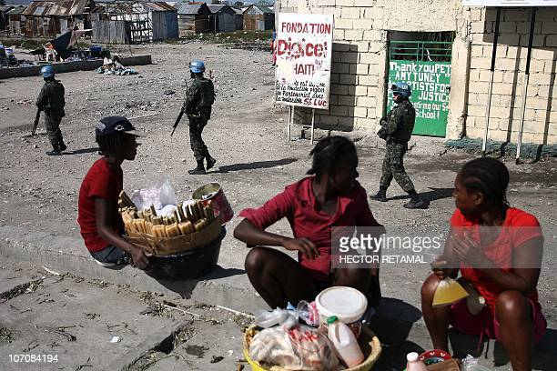 Brazilian UN peacekeepers patrol through Cite Soleil, the biggest slum on the outskirts of the Haitian capital Port-au-Prince, on November 22, 2010....