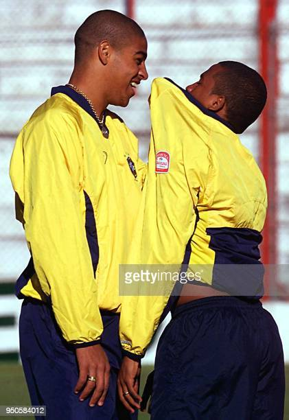 Brazilian Under20 soccer player Adriano Ribeiro jokes around with his teammate Andre Luciano 19 June 2001 during parctice in Cordoba Argentina El...