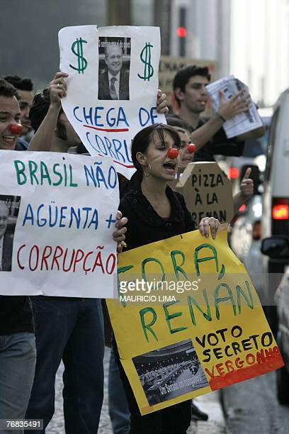 Brazilian university students of journalism hold banners calling for the dismissal of Brazil's Senate president Renan Calheiros during a protest in...