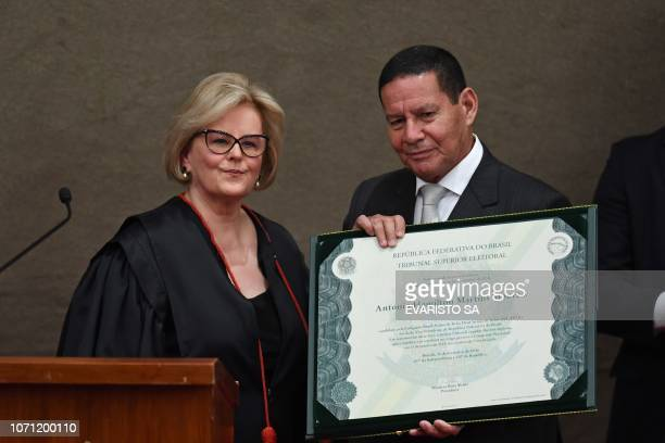 Brazilian VicePresidentelect Hamilton Mourao displays a diploma that certifies he can take office as vicepresident next to Electoral Supreme Court...