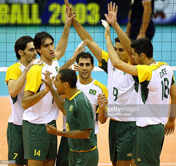 Brazilian volleyball players LR Gilberto Godoy Filho Rodrigo Santana Sergio Santos Mauricio Lima Andre Nascimento and Dante Amaral celebrates their...