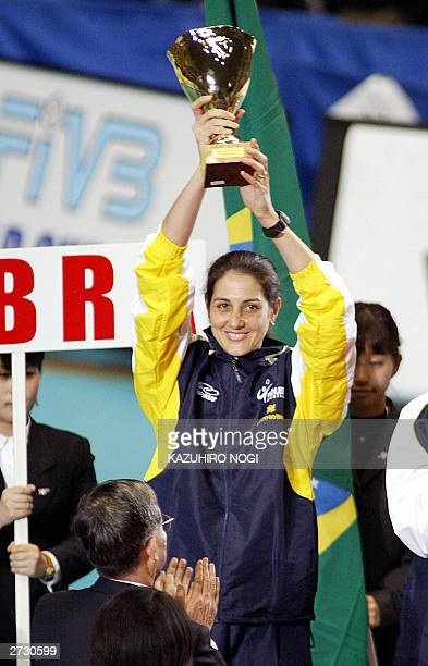 Brazilian volleyball team captain Fernanda Venturini holds up the second place trophy during the awards ceremony at the World Cup women's volleyball...