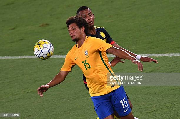Brazilian Willian Arao contests the ball with Fernando Uribe of Colombia during a friendly football match in benefit of Chapecoense football team at...
