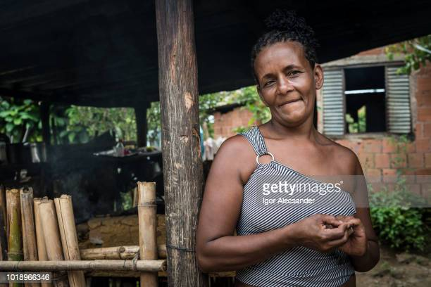 brazilian woman at her home in the kitchen of a wood stove - humility stock pictures, royalty-free photos & images