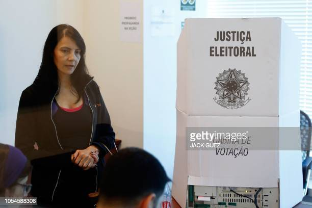 A Brazilian woman casts her ballot at the Brazilian embassy in the Israeli city of Tel Aviv on October 28 2018 during the second round of the...