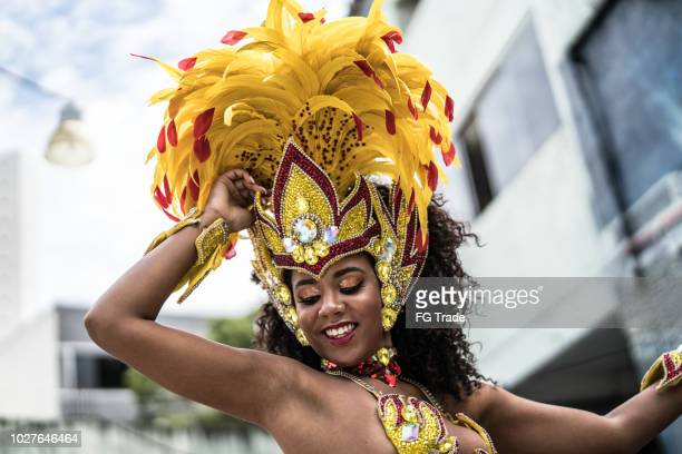 brazilian woman dancing samba for the famous carnival parade - mardi gras parade stock photos and pictures