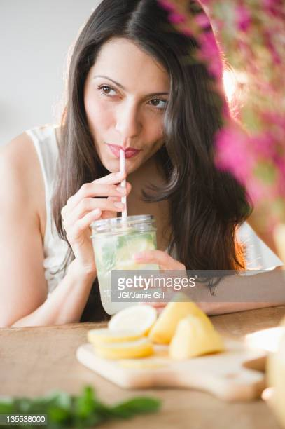 Brazilian woman drinking lemonade