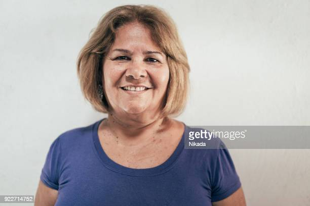 brazilian woman in front of white wall