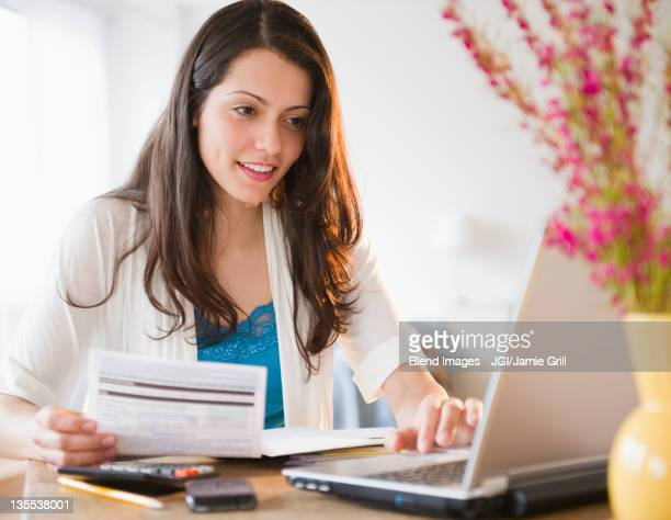 Brazilian woman paying bills online