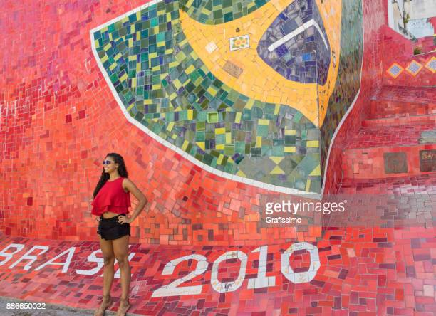 Brazilian woman posing for a photo in Rio de Janeiro near the Escaderian Selaron