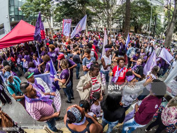 A Brazilian woman wears an earring reading 'Temer out' as she takes part in the commemoration of the International Women's Day in Sao Paulo Brazil on...