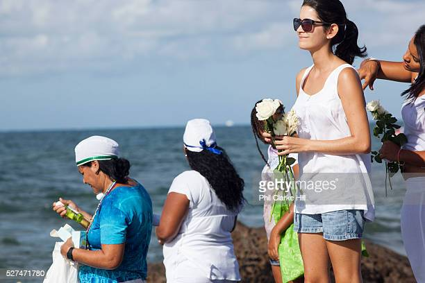 Brazilian women making offerings of flowers to the sea in honour of Yemanja February 2nd is the feast of Yemanja a Candomble Umbanda religious...