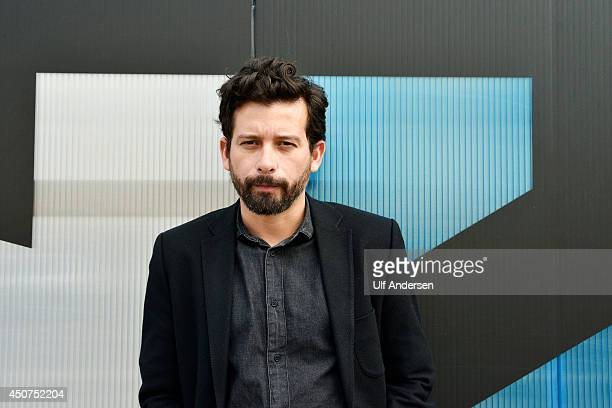 Brazilian writer Joao Paulo Cuenca poses during portrait session held on June 8 2014 in Saint Malo France
