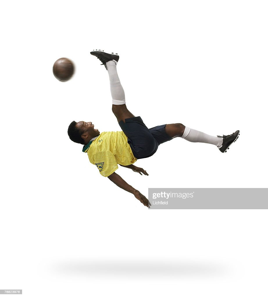 Brazilian-born Edson Arantes do Nascimento, better known by his nickname Pele, former football player, rated by many as the greatest footballer of all time, photographed in the Studio recreating his bicycle kick on 12th September 2003. (Photo by Lichfield/Getty Images).