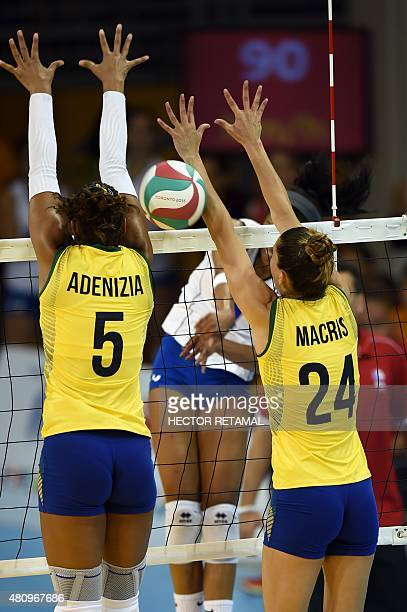 Brazilians Adenizia Da Silva and Macris Carneiro try to block the ball during the Volleyball Women Preliminary against to Puerto Rico at the 2015 Pan...