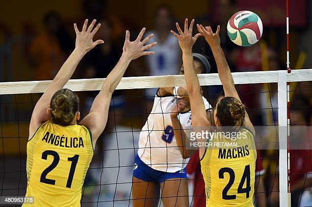 Brazilian's Angelica Malinverno and Macris Carneiro vie for the ball with Aurea Cruz of Puerto Rico during the Women's Volleyball Preliminary at the...