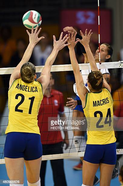 Brazilian's Angelica Malinvero and Macris Carneiro vie for the ball during the Women's Volleyball Preliminary at the 2015 Pan American Games in...