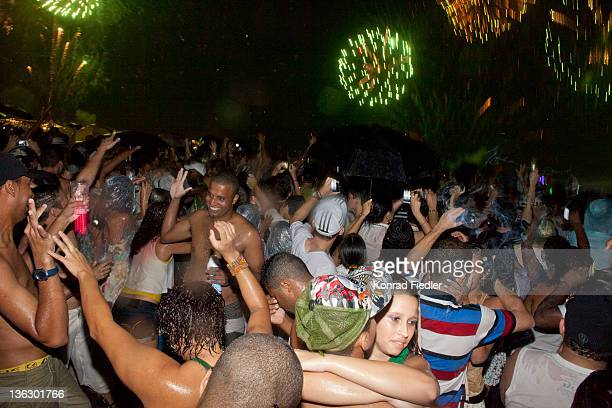 Brazilians celebrate at the annual New Year's Eve beach party on December 31 2011 for the Copacabana Reveillon in Rio De Janeiro Brazil One of the...
