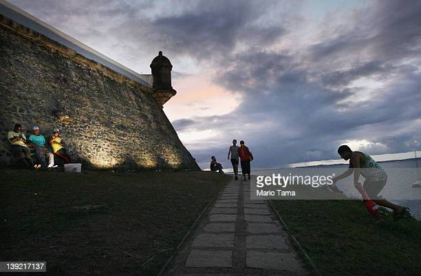 Brazilians gather at a lighthouse along a parade route on the second day of Carnival celebrations on February 17 2012 in Salvador Brazil Carnival is...