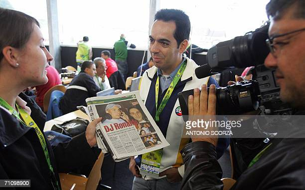 Brazilians journalists film the page of the Swiss' newspaper 'Blick' where appears Brazilians players Ronaldo Nazario Emerson and Roberto Carlos...