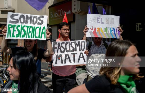 Brazilians living in Chile take part in a demonstation against Brazilian rightwing presidential candidate Jair Bolsonaro called by a social media...