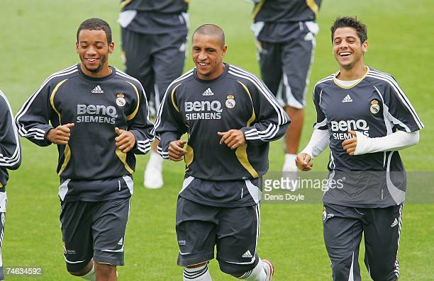 Brazilians Marcelo Roberto Carlos and Cicinho of Real Madrid warm up during the team training session at the Valdebebas grounds on June 15 2007 in...
