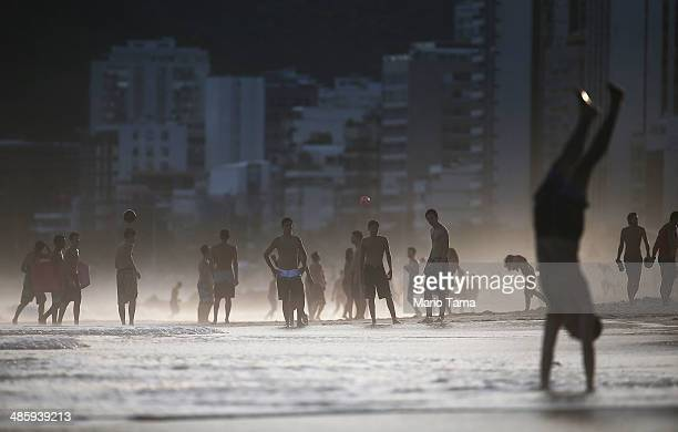 Brazilians play altinha a spinoff of soccer played on the beach as others gather on Ipanema Beach on April 21 2014 in Rio de Janeiro Brazil Altinha...