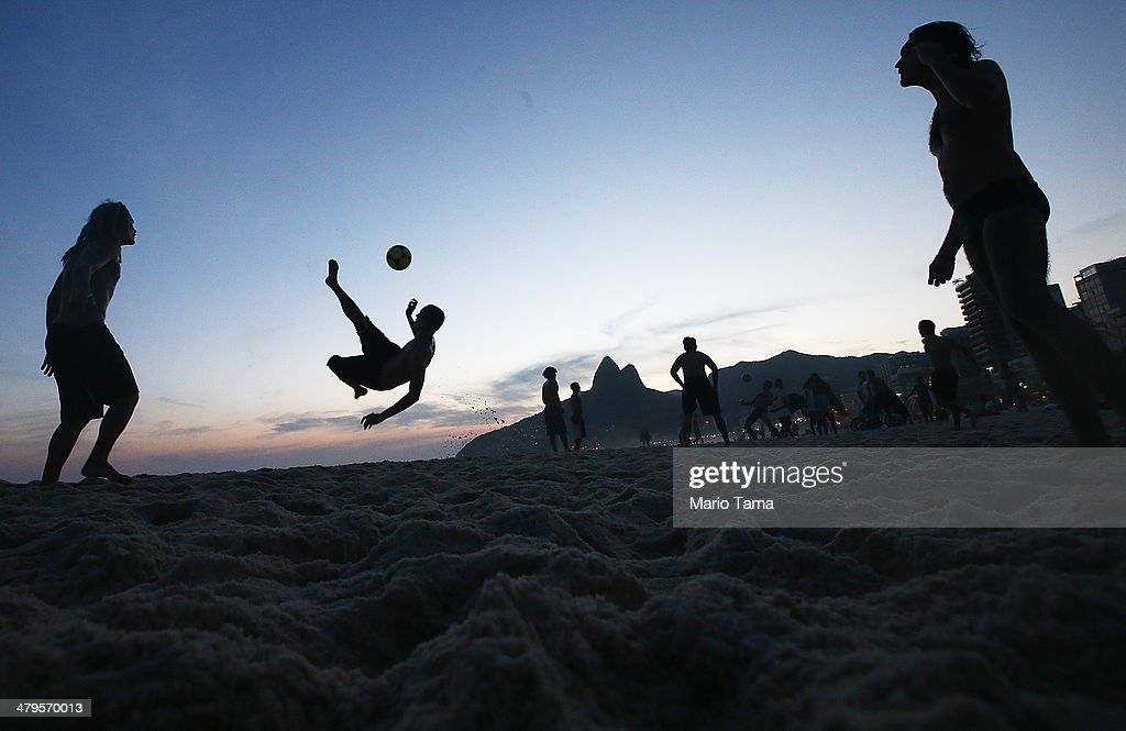 Brazilians play altinha, a spin-off of soccer played on the beach, on Ipanema Beach on March 19, 2014 in Rio de Janeiro, Brazil. Altinha is Portuguese for 'a little higher' and involves players attempting to keep the ball in the air without using their hands. Brazilians play many spin-offs of soccer including altinha, footvolley and futsal. Brazil is gearing up to host the 2014 FIFA World Cup in June.