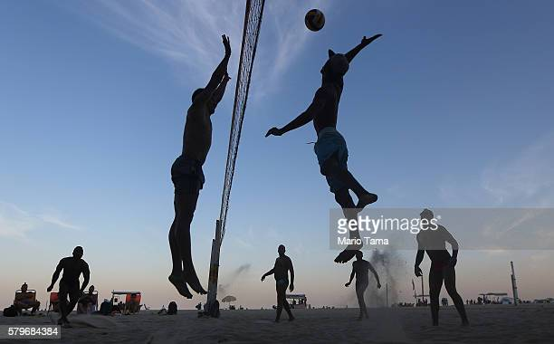 Brazilians play beach volleyball on Copacabana beach near the Rio 2016 Olympic Games beach volleyball stadium on July 24 2016 in Rio de Janeiro...