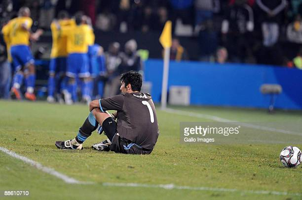 Brazilians players celebrate as goalie Gianluigi Buffon of Italy sits on the pitch dejected during the FIFA Confederations Cup match between Italy...