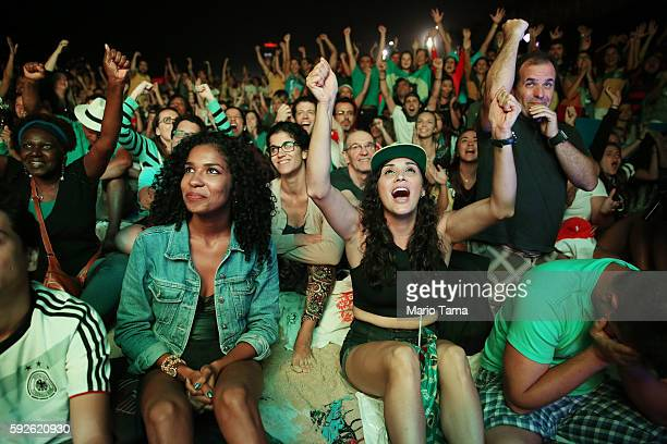Brazilians react during the second half before their team defeated Germany to win the soccer gold medal during the Rio 2016 Olympic Games while...