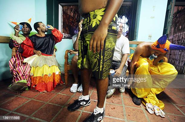 Brazilians relax after performing in traditional Carnival costumes on the first day of Carnival celebrations on February 16 2012 in Salvador Brazil...