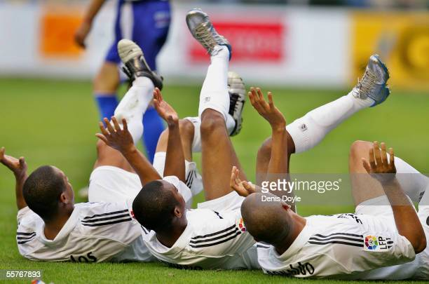 Brazilians Roberto Carlos Robinho and Ronaldo of Real Madrid celebrates after Ronaldo scored a goal during a La Liga soccer match between Alaves and...