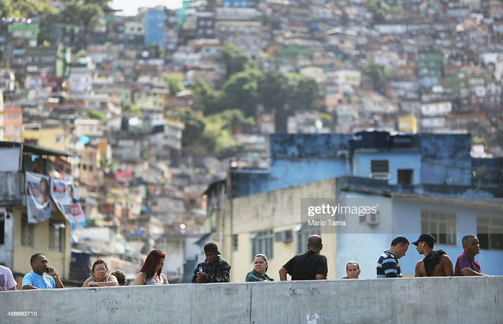 Brazilians wait in line to enter a polling station in the Rocinha favela, or community, on the day of national elections on October 5, 2014 in Rio de Janeiro, Brazil. Incumbent President Dilma Rousseff is competing against social democrat Aecio Neves and environmentalist Marina Silva with a run-off vote expected October 26.