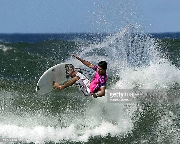 Brazillian Bernardo Pigmeu surfs a wave during the finals of the Vans Triple Crown of Surfing November 22 2004 at Ali'i Beach Park in Haleiwa Hawaii...