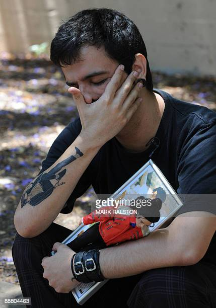 A Brazillian fan reacts putside the gates of the rented Holmby Hills residence of music legend Michael Jackson in Los Angeles on July 2 2009 Funeral...