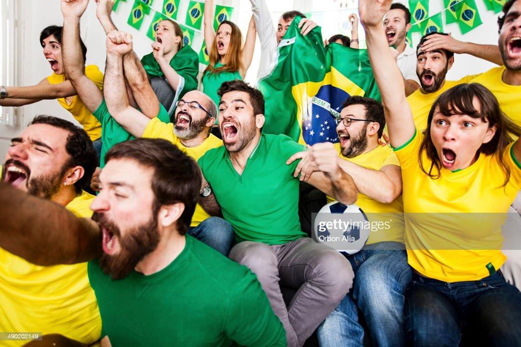 Adeptos brasileiro : Foto de stock