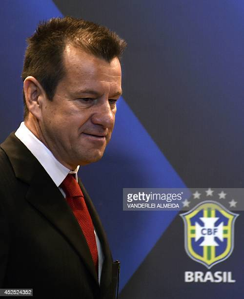 Brazil's 1994 WorldCup winning skipper Carlos Verri better known as 'Dunga' arrives for his presentation as the new coach of the Brazilian national...