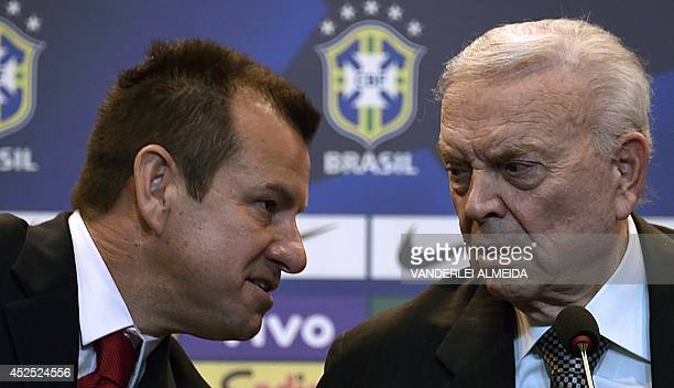 Brazil's 1994 WorldCup winning skipper Carlos Verri better known as 'Dunga' talks to the president of the Brazilian Football Confederation Jose Maria...