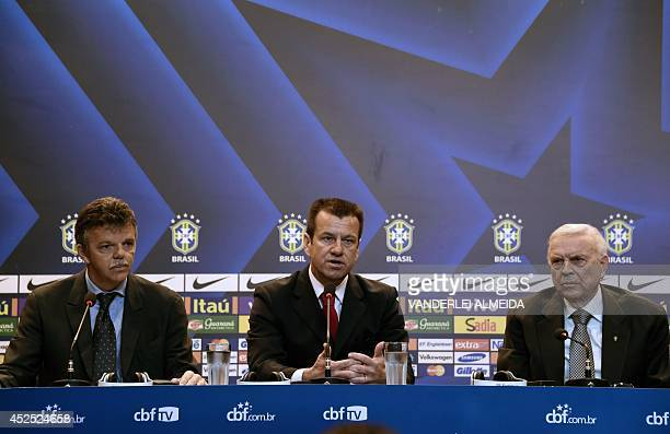 Brazil's 1994 WorldCup winning skipper Carlos Verri better known as 'Dunga' speaks next to the president of the Brazilian Football Confederation Jose...