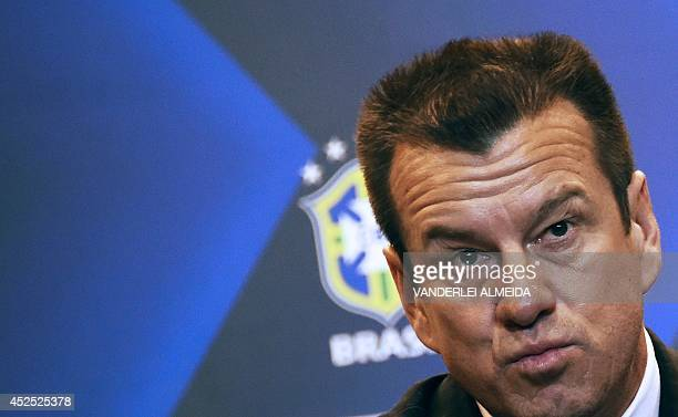 Brazil's 1994 WorldCup winning skipper Carlos Verri better known as 'Dunga' speaks during his presentation as new coach of the Brazilian national...