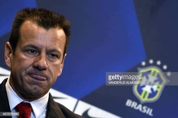 Brazil's 1994 WorldCup winning skipper Carlos Verri better known as 'Dunga' is presented as the new coach of the Brazilian national football team at...
