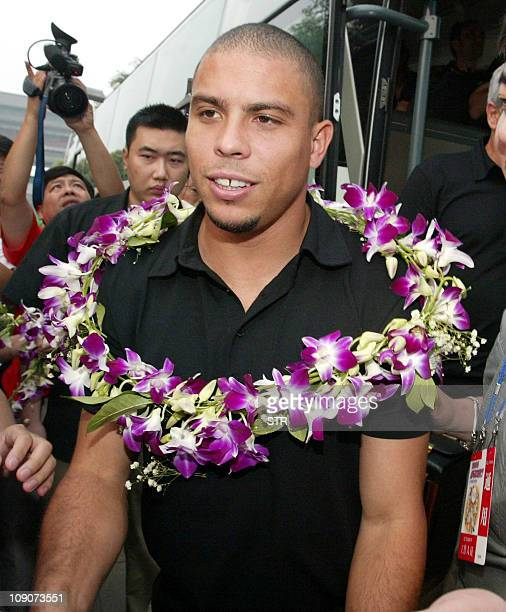 Brazil's 2002 World Cup final goalscoring hero Ronaldo arrives with the Spanish football giant Real Madrid team at a hotel in the suburbs of Beijing...