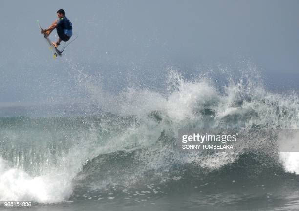 Brazil's Adriano De Souza competes during the 2018 World Surf League Men's Championship Tour at Keramas in Gianyar regency on Indonesia's resort...