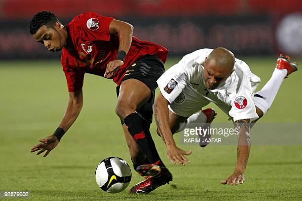 Brazil's Afonso Alves of AlSadd club vies with AlRayyan's Hamed Ismail during their Qatar Stars League football match in Doha on November 7 2009 AFP...